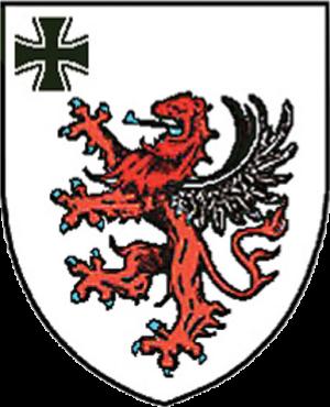 Wappen des ehemals in Gießen stationierten Verteidigungsbezirkskommandos VBK 47: Mit Eisernem Kreuz und dem Gießener Löwen. Quelle: Wikipedia